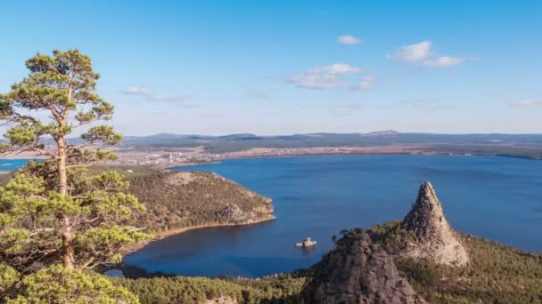 Majestic nature of Kazakhstan concept: epic view of Burabay lake with Okzhetpes and Zhumbaktas rocks from the highest point of Sinyuha Mountain at sunset in autumn season; time lapse
