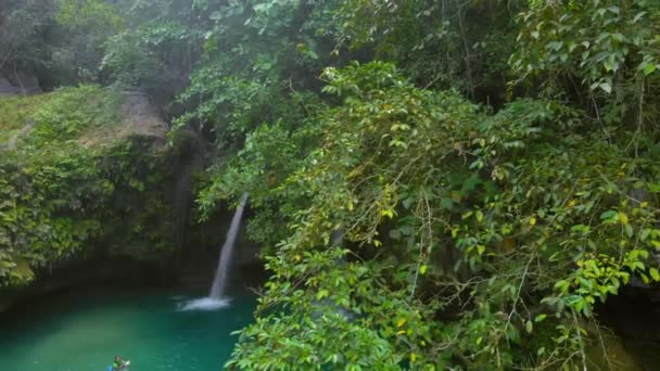 Tropical waterfall Kawasan Falls surrounded by green nature at Cebu island in Philippines