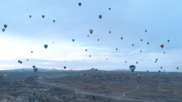 Aerial footage of Hot air balloons flying over the valley in Cappadocia, Turkey. Aerial view of Hot Air Balloons from Cavusin region of Cappadocia.