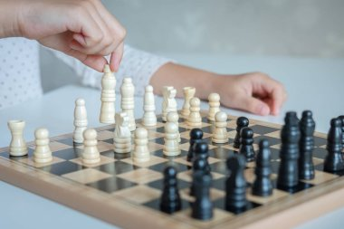 a girl learn how to play chess game