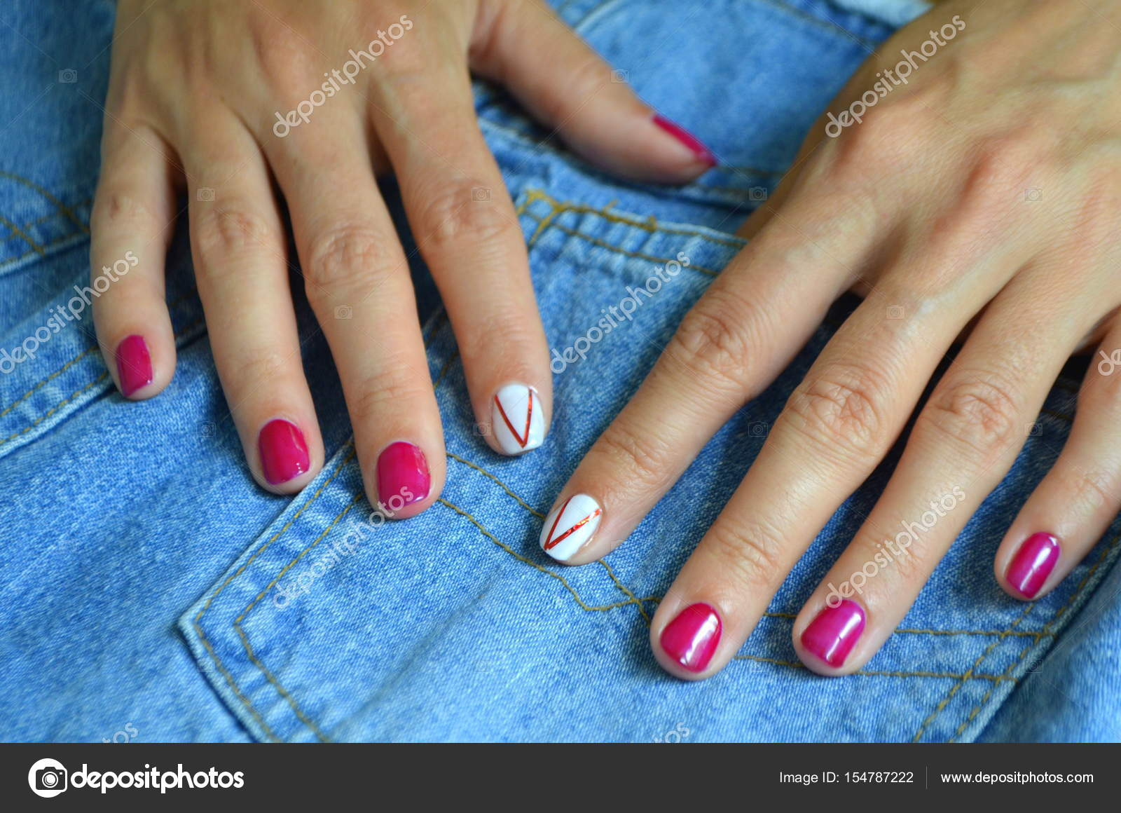 Manicure short red nails and white on the index finger — Stock Photo ...