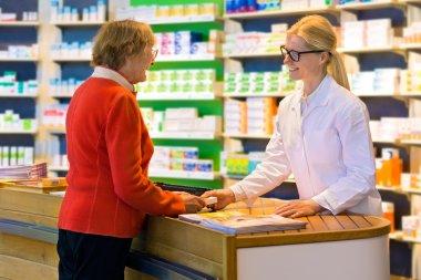 pharmacist giving prescription drugs