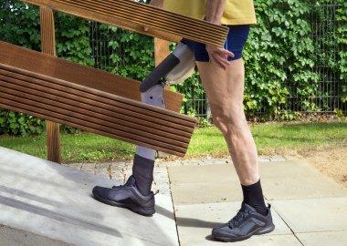 Man walking on ramp with false leg