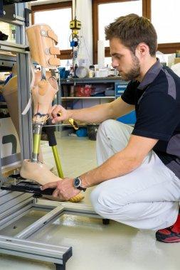 Man working on prosthetic leg