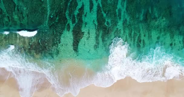 Aerial View Ocean Waves Crashing On Topical Shoreline Of White Sand Beach On Summer Beach Day With Coral Reef
