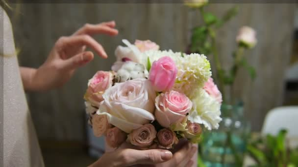 Tender female fingers touch beautiful bouquet