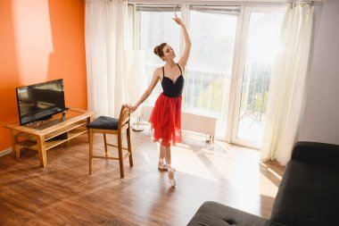 Ballet dancer stretch and dance at home