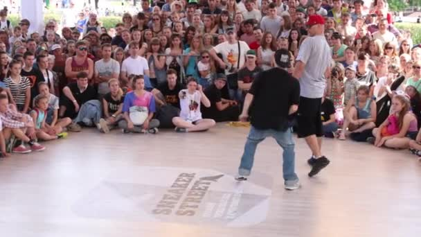 Guy dances at Street fight festival on street stage during Day of Russia holiday