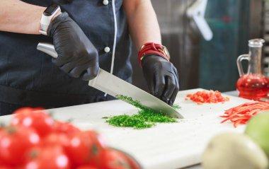 cook preparing dinner in a restaurant kitchen.