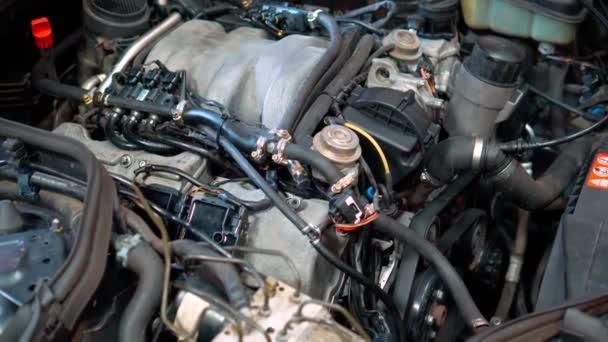 Car repair shop - engine under the car hood. Automobile car engine bay in garage industry