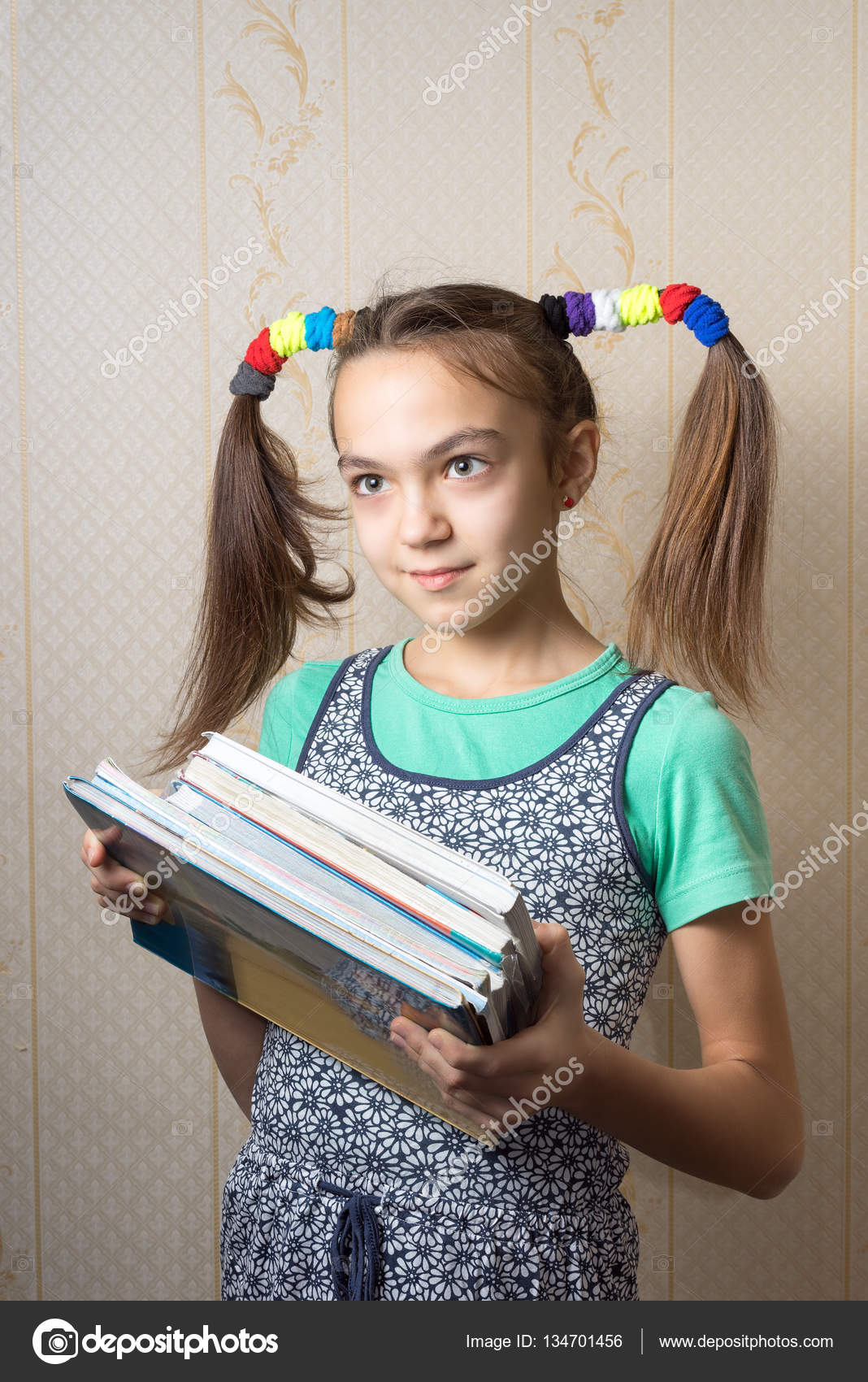 11 Year Old Girl With Funny Tails Is With A Pile Of Books