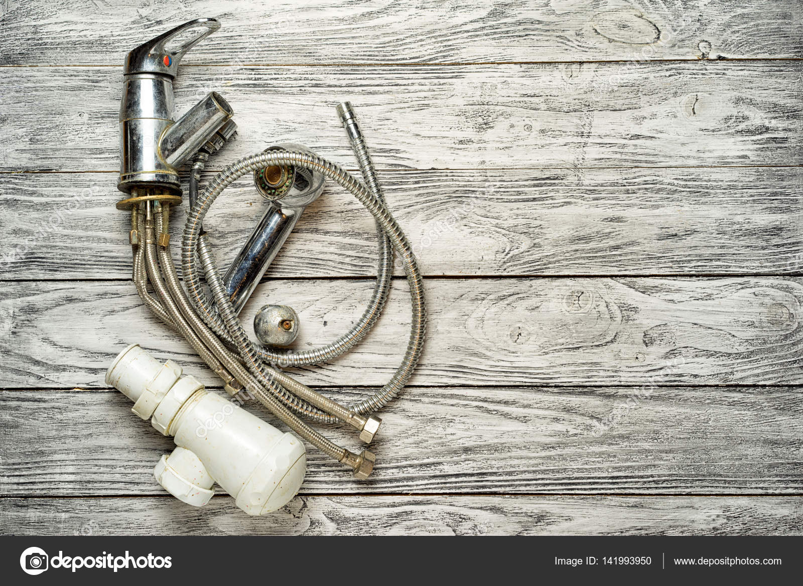 old broken faucet water on a wooden background, top view, copy space ...