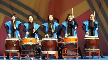 Moscow, Russia - May 14, 2017: The group of taiko drummer girls Taiko inspiration performs on the festival of martial arts One in the field is warrior.
