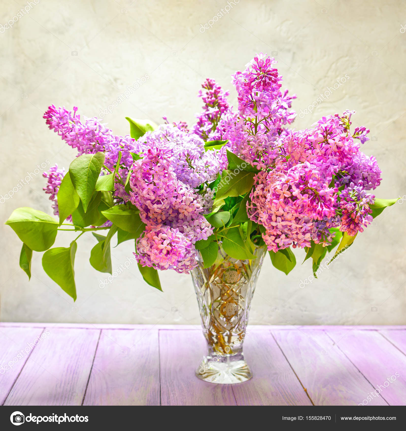 still life bouquet of lilac flowers on the table — Stock Photo © Elf ...