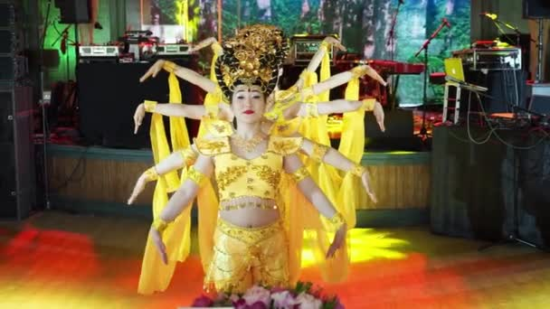 group of five asian women actresses in traditional chinese yellow costumes dancing the dance many-armed goddess