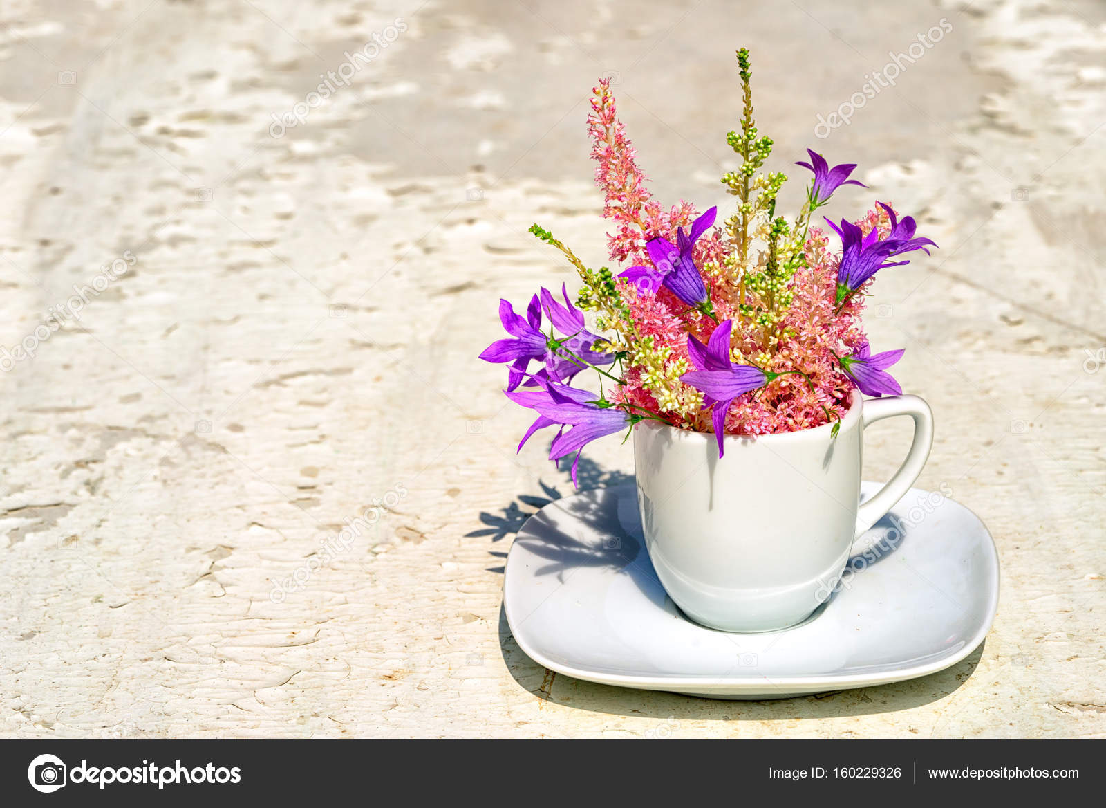 Astilba and blue bell flowers bouquet in a white coffee cup on an astilba and blue bell flowers bouquet in a white coffee cup on an old white background with copy space for your text photo by elf11 mightylinksfo Gallery