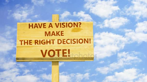 Have a vision? Make the right decision. Vote! Words on a wooden sign against time lapse clouds in the blue sky.