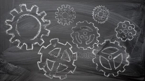 Ozubená kola mechanismus křída kresby animace na tabuli jako koncepce týmové práce.