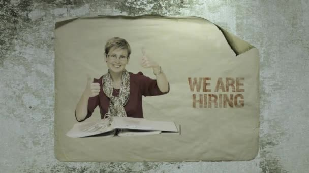 old paper job ad on a cement wall with a portrait of a staff member showing ok signs by her hands, imitation of camera shake and light flashes. busines recruitment concept.