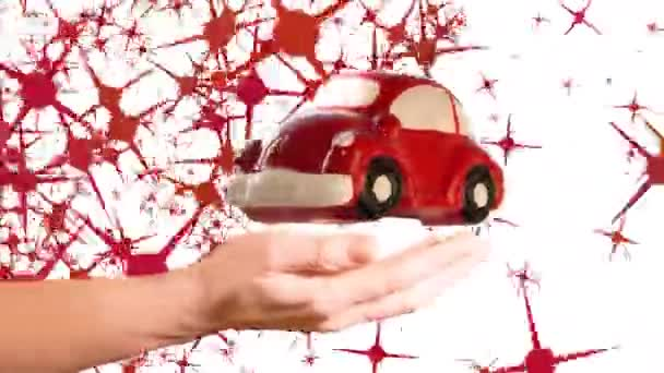 Red toy car model turning over woman hand on a white background with stars shape animation.