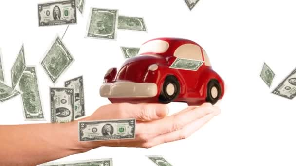 car expenses concept. rotating red toy car on a hand with rain of dollar banknotes on a white background.