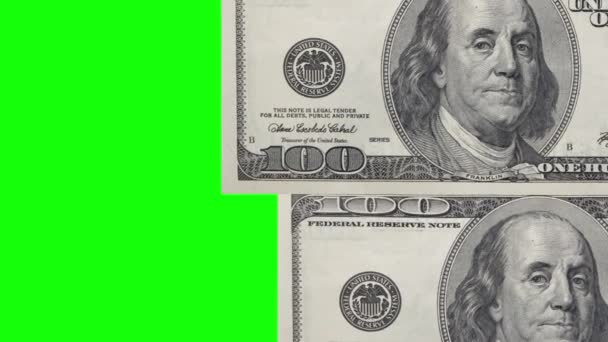 One hundred dollars banknotes circled isolated on chroma key background with copy space for your video at the left side.