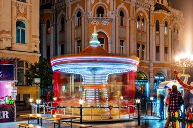 Novi Sad, Serbia - December 04, 2019: Novosadski Winter Fest. A blurry colorful carousel in motion.
