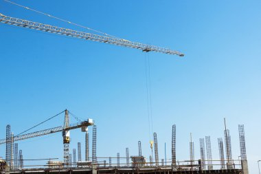High lift Crane and Worker Woking on Construction Site