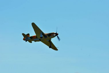 Memorial Airshow. Aircraft Jak-9 in aviation fair and century air combats.