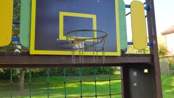 ball going through basket hoop in school basketball court