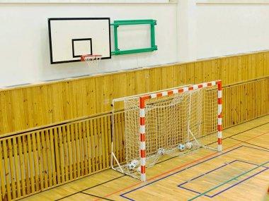 Basketball board and futsal gate in school gym.  Central heating