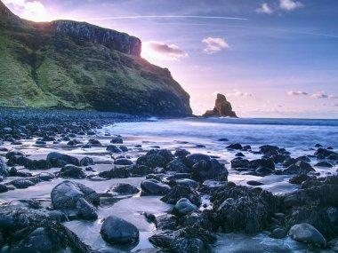 Rocky coast of sea. Slow shutter speed for smooth water level. Visite Talisker Bay