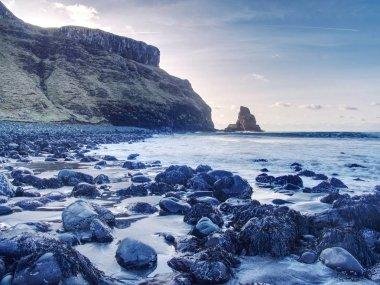 Amazing sunset, Talisker bay on the Isle of Skye in Scotland. Foamy sea