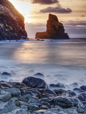 Rocky coast of sea. Slow shutter speed for smooth water level. Visite Talisker Bay on the Isle of Skye in Scotland at sunset