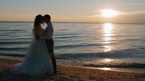 Bride and groom near the sea