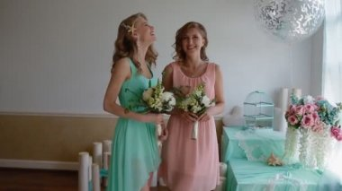 Beautiful bridesmaids with flowers