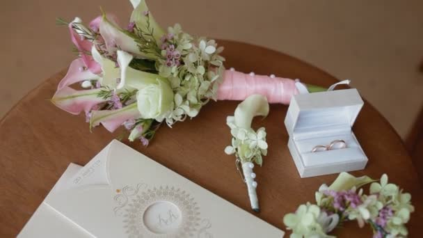 Wedding bouquet lies on table with engagement accessories