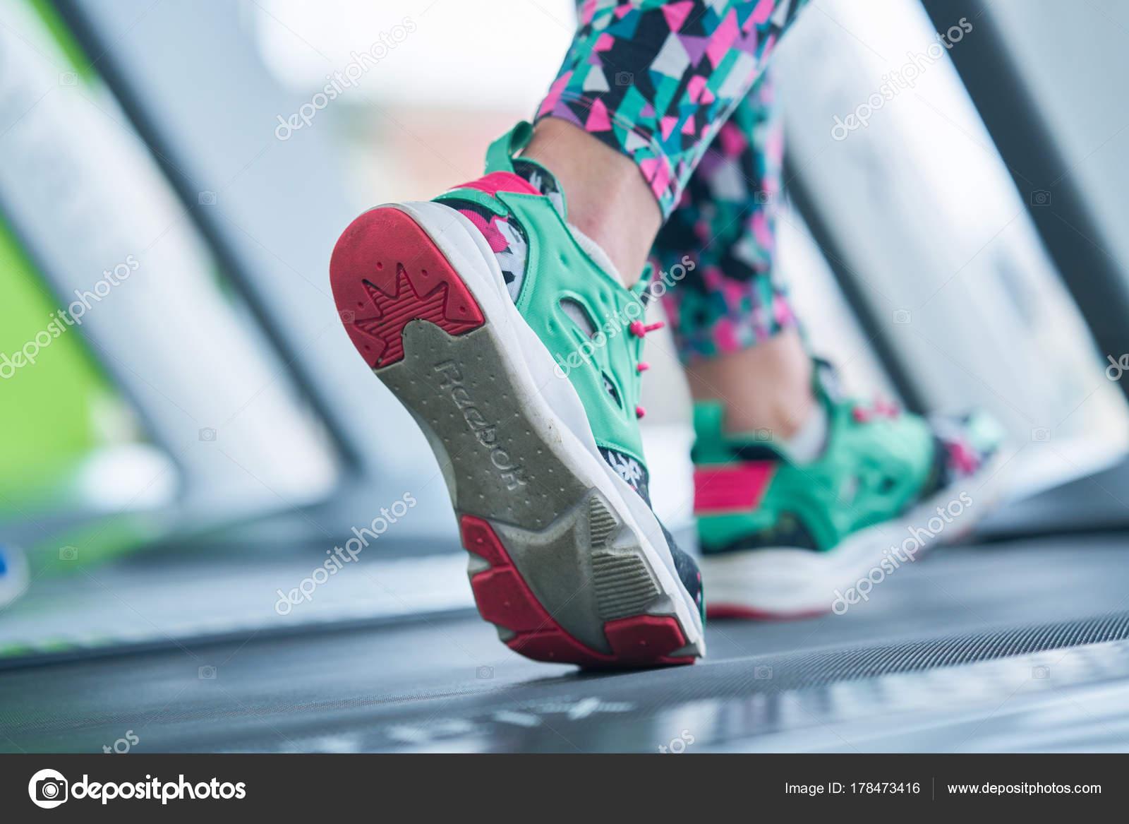 Female Muscular Feet Sneakers Running Treadmill Gym Stock Photo