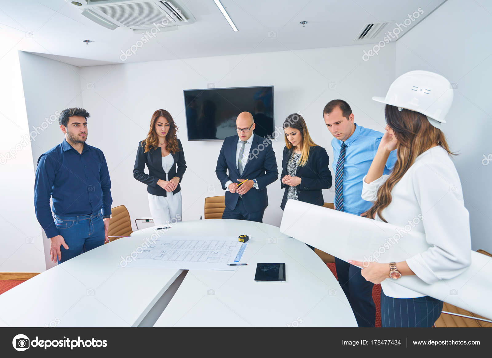 Business people group meeting construction engineer architect business people group meeting construction engineer architect looking building blueprint stock photo malvernweather Images