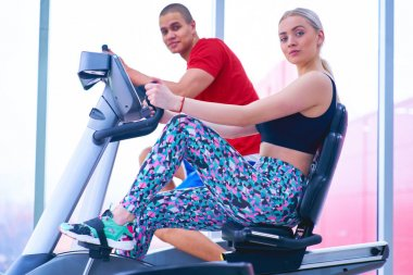 Woman training with fitness instructor at the gym