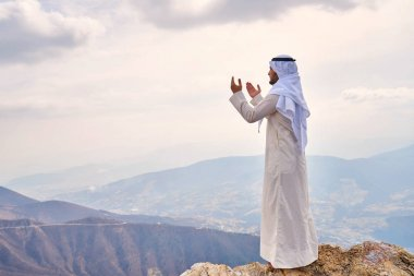 The iIslamic man praying   on the mountain.
