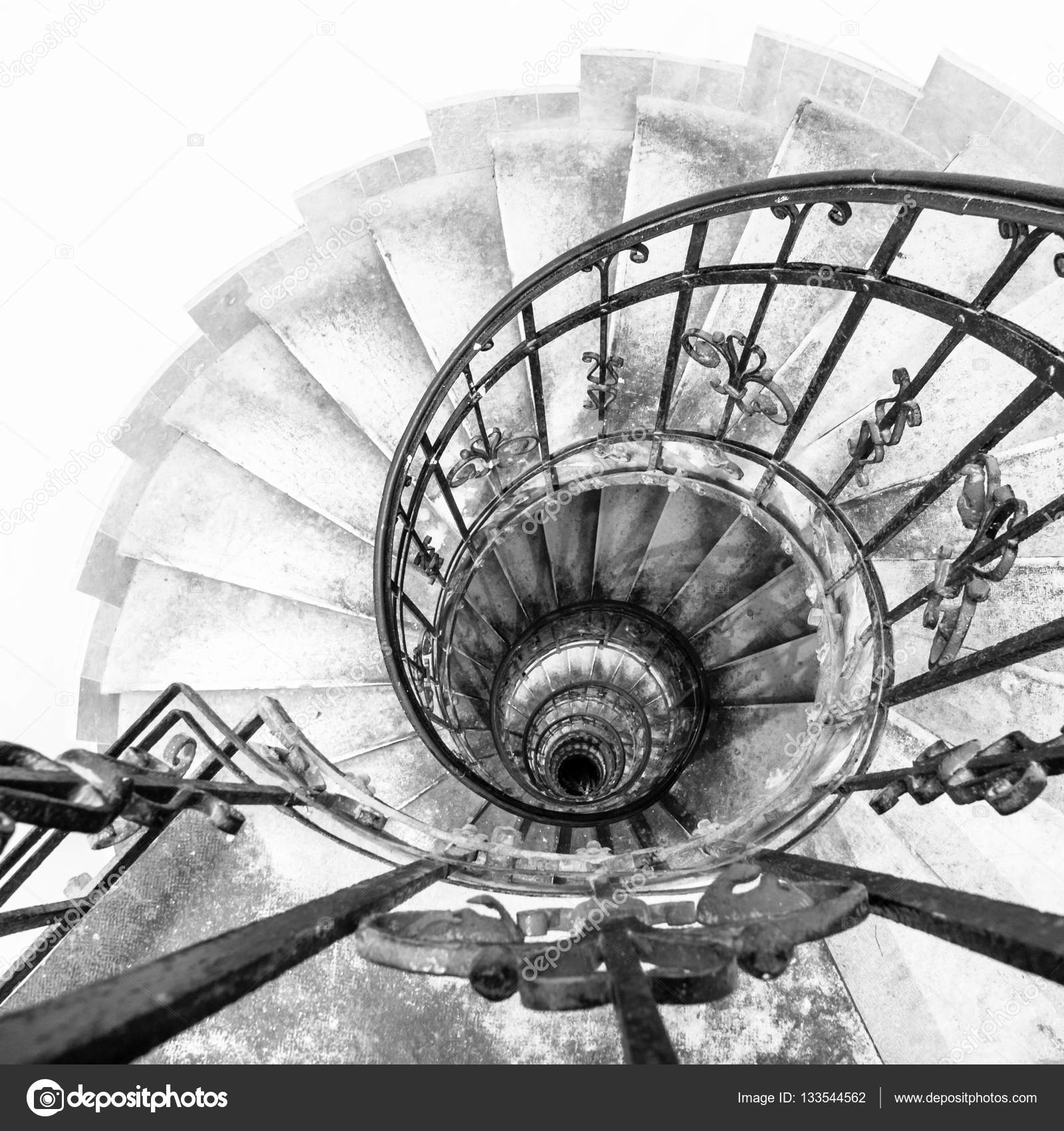 Upside View Of Indoor Spiral Winding Staircase With Black Metal Ornamental  Handrail U2014 Stock Photo