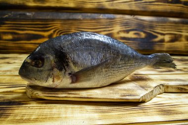 darado fish on a wooden table