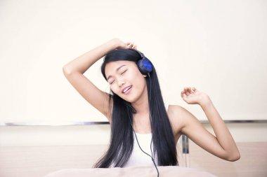 Happy cheerful girl listening music