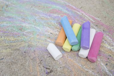 Colorful chalks on the street, background