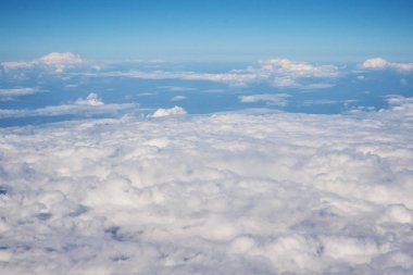 Aerial view of fluffy clouds. Top view of a beautiful cloudscape