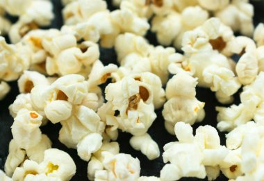 Background from popcorn closeup on a black background.