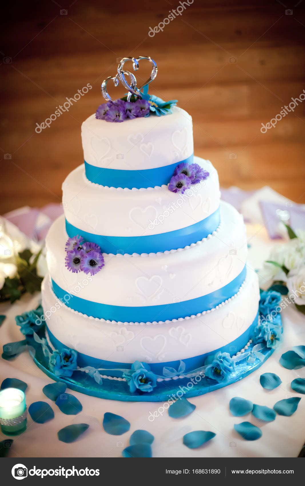 Colorful blue and purple wedding cake with silver wedding topper ...