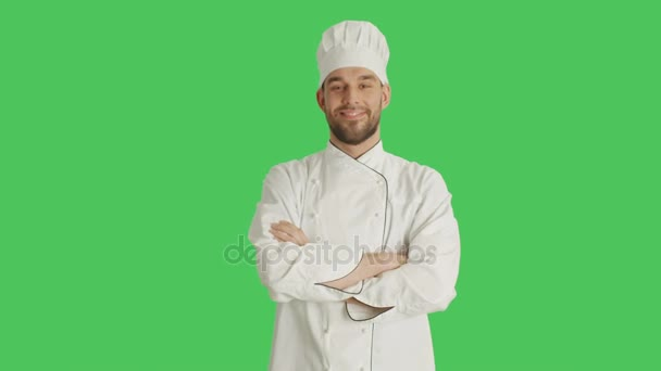 Mid Shot of a Handsomer Chef Crossing His Arms and Smiling. Background is Green Screen.