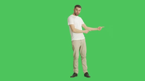 Long Shot of a Casual Man Doing Finger Gun/ Presenting Gesture Good for Selling Your Particular Product. Shot on a Green Screen Background.